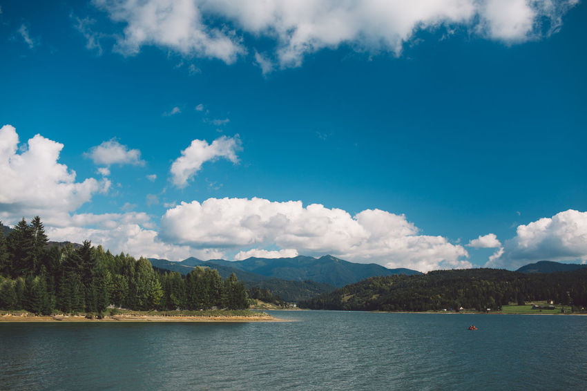 Water Cloud - Sky Sky Scenics - Nature Beauty In Nature Mountain Day Tree Tranquility Nature Tranquil Scene Waterfront Lake Plant No People Idyllic Outdoors Mountain Range Blue