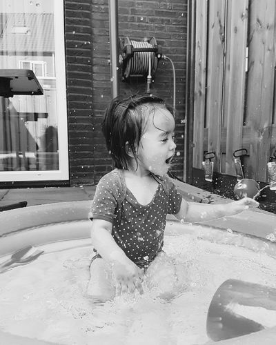 Cute Girl Splashing Water In Wading Pool