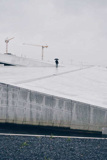 Person Walking On Walkway At Oslo Opera House