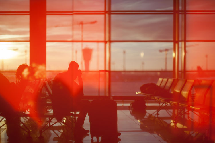 Waiting at Munich Airport in the morning during sunrise Window Airport Transportation Chair Seat Group Of People Men Sky Sunlight Transparent Real People Orange Color Mode Of Transportation Business Nature Airport Departure Area Glass - Material Sitting Waiting Reflections And Shadows Indoor Photography Travelling Sunrise First Eyeem Photo