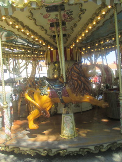 Paint The Town Yellow Amusement Park Amusement Park Ride Animal Representation Arts Culture And Entertainment Carousel Carousel Horses Day Illuminated Indoors  No People Sculpture Statue