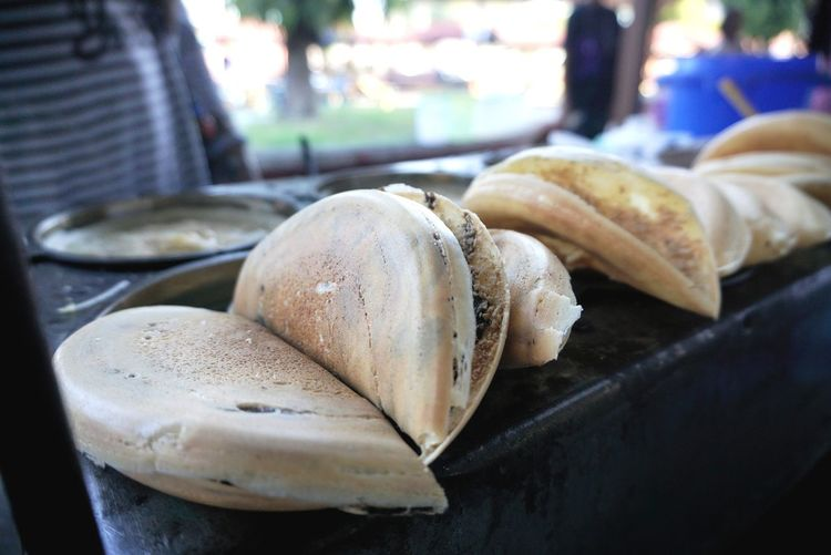 A pancake-style snack wedded with the compact package of an omelet, apam balik is stuffed with more than a sufficient amount of sugar, peanuts and the occasional sprinkle of corn. It's stall at street market. Apam Apam Balik Peanut Traditional Food Halal Halalfood Crispy Product Foodphotography Malaysianfood Food Close-up Food And Drink Stall Served Market Prepared Food Market Stall Display Street Market Serving Size