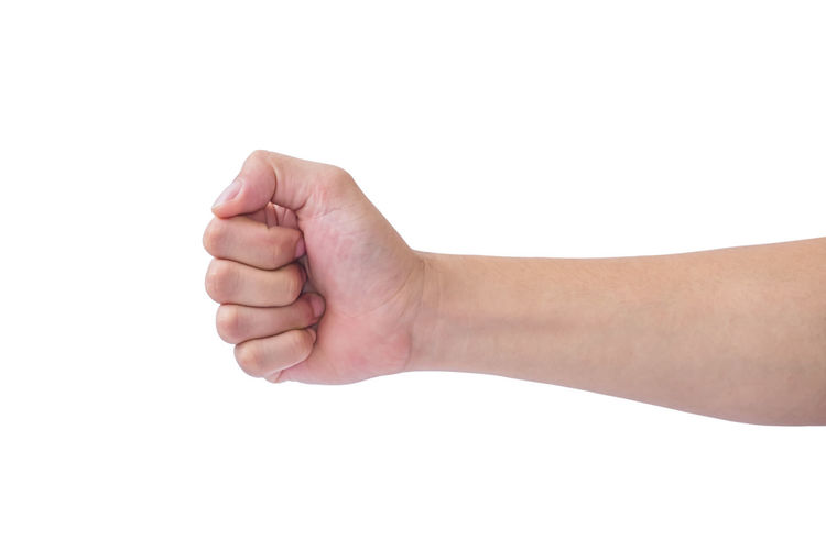 Man hand showing fist symbol on white background. clipping path. Isolated Hands White Background Holding Arm Concept Gestures Close Up Caucasian Collection People person Bottle Symbol Adult Human Hand Body Part Communication Fingers Clipping Path Pushing Thumbs Fist