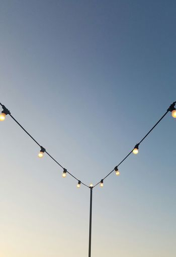 String lights Dusk String Of Lights Blue Sky Shading  Summer Patio Symetry Angles And Lines