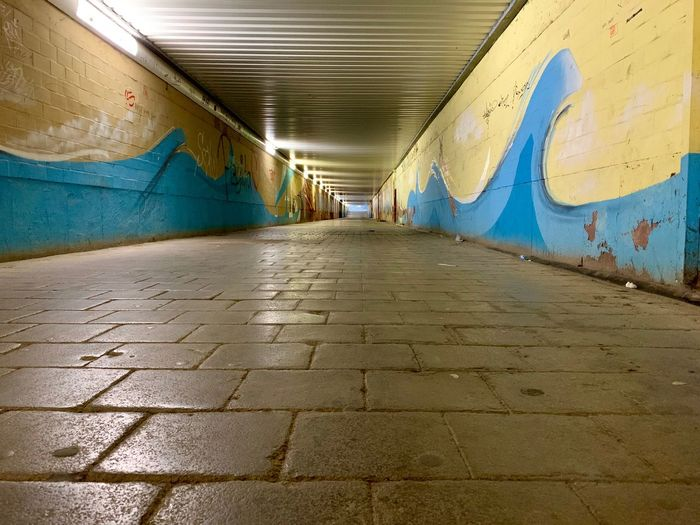 Direction The Way Forward Graffiti Architecture Transportation Diminishing Perspective Built Structure Footpath No People Day Indoors  Flooring Illuminated Wall - Building Feature Subway Ceiling Wall Tunnel Surface Level Long