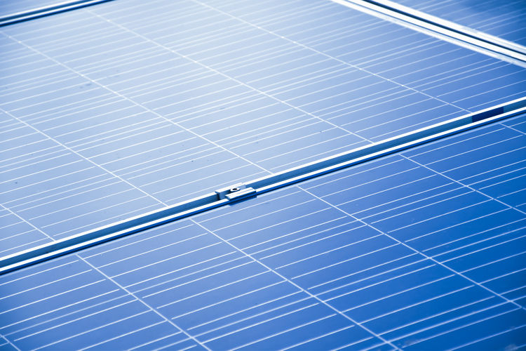 Closeup view of photovoltaic panels surface which installed on the building's roof after washing.