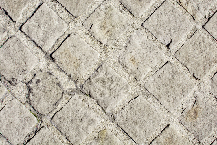 Stone pavement texture for path walk Path Walk Sidewalk Concrete Flooring Footpath High Angle View No People Pattern Pavement Paving Stone Rough Stone Stone Material Street Texture Tile Walkway