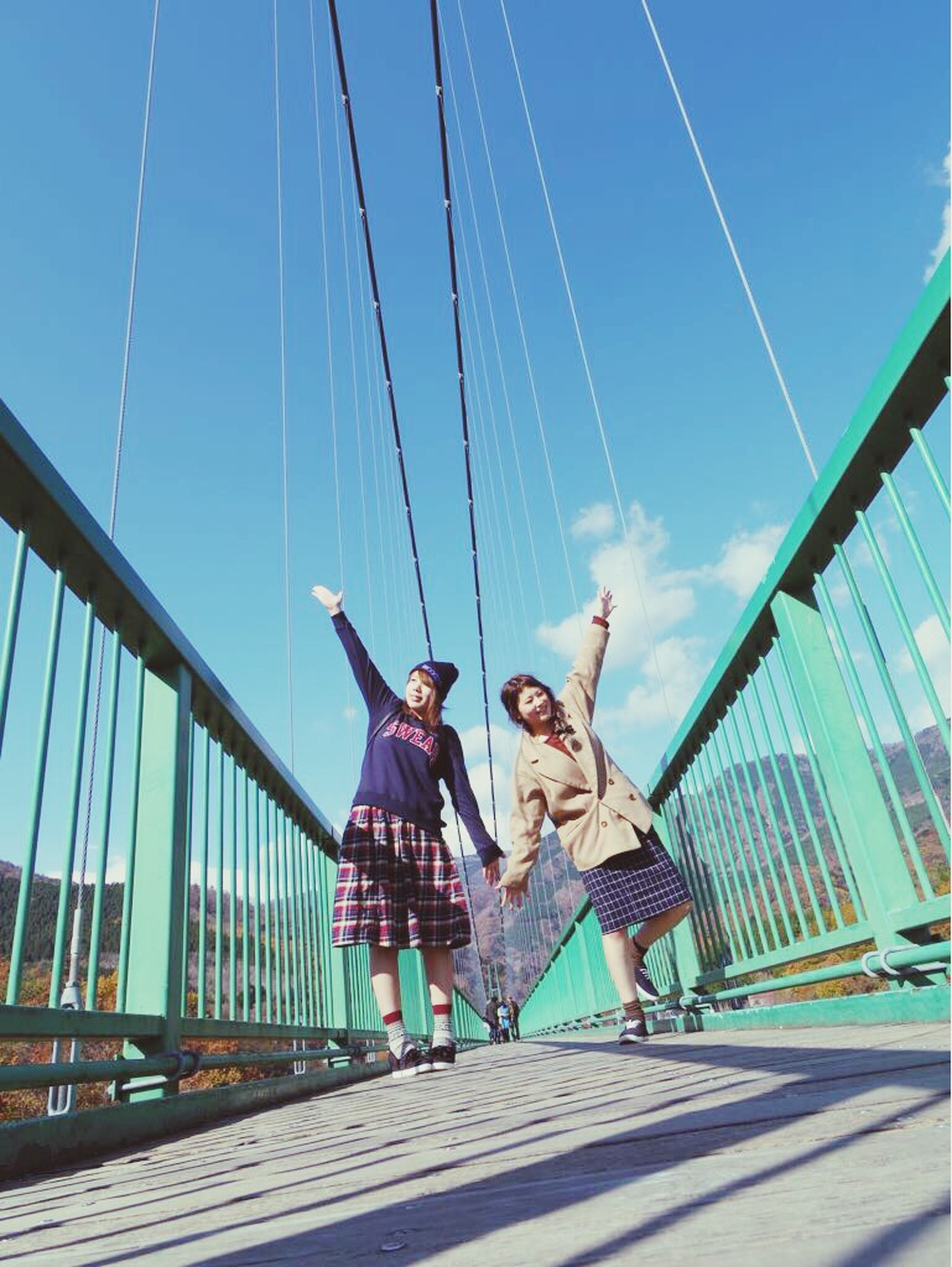 lifestyles, leisure activity, full length, casual clothing, fun, person, enjoyment, young adult, young women, happiness, togetherness, sky, girls, boys, childhood, low angle view, playing