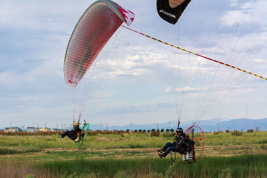 Powered Paragliders flying low. Activity Adventure Cloud - Sky Day Extreme Sports Flying Fun Hangglider Leisure Activity Mid-air Outdoors Paragliding Powered Paraglider Sky Sport Unrecognizable Person
