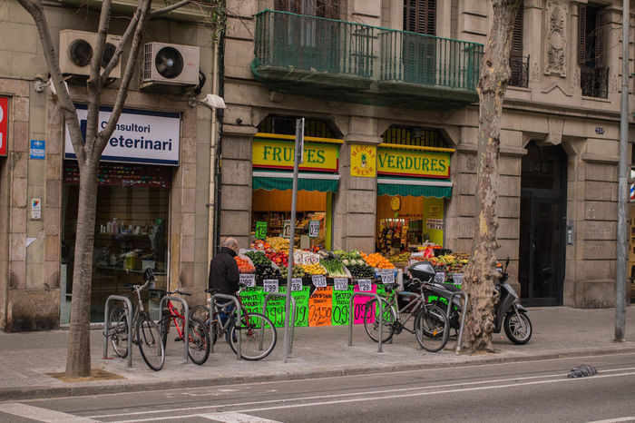 Air Conditioner Barcelona Barcelona, Spain Bike Lane City Urban Lifestyle Architecture Balcony Bicycle Bike Parking Bike Station Bikes City Day Fruit Shop Fruits Land Vehicle No People Outdoors Parked Bike Transportation Urban Urban Life Vegetable Vegetables