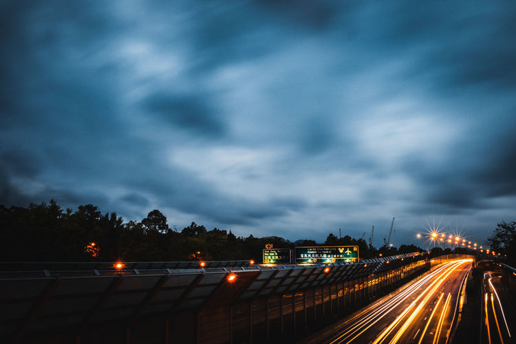 City Cloud - Sky Cloudy Dark Dusk EyeEmNewHere Highway Illuminated Light Lighttrails Lines Long Exposure Moving Clouds Nature Night Lights No People Outdoors Road Sky Speed Storm Cloud Time Transportation Tree Urban