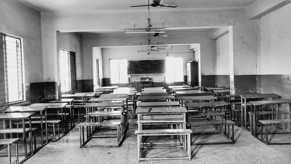 Chair Wood - Material Indoors  Table No People Desk Architecture Seat Furniture Day Sophisticated Black And White School Classroom Classroom Table Chalk Board Benches. Class Rooms. No Ppl. EyeEmNewHere Moments To Remember  EyeEm Selects Investing In Quality Of Life Breathing Space The Week On EyeEm Black And White Friday