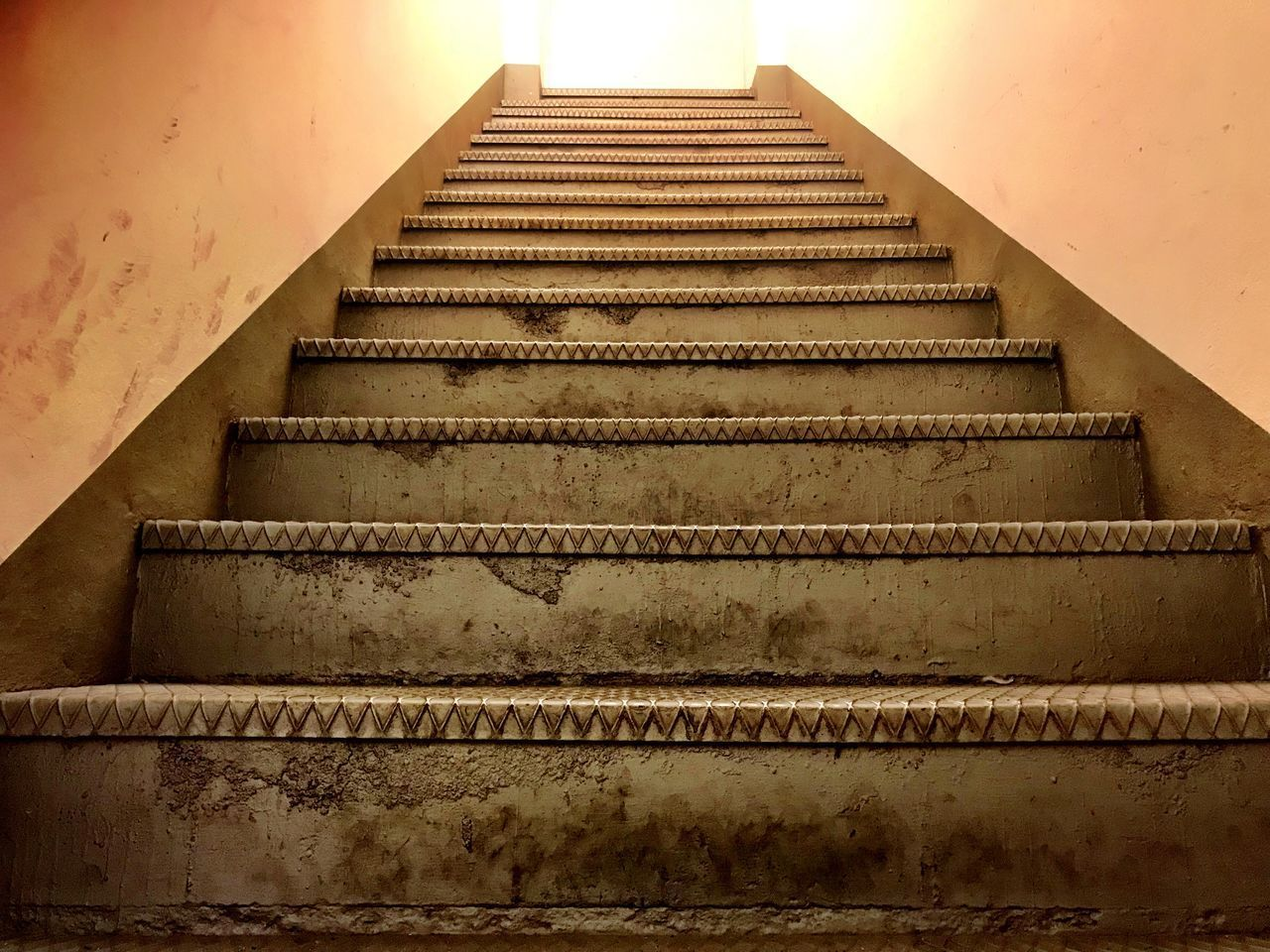 staircase, architecture, steps and staircases, built structure, no people, pattern, low angle view, railing, direction, the way forward, wall - building feature, indoors, metal, day, repetition, diminishing perspective, moving up, building