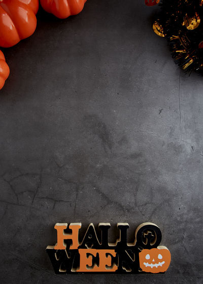 Halloween background pumpkin with wooden text objects on a dark Cement textured, flat lay banner Text Pumpkin Holiday Decoration Flat Lay Table Halloween Orange Top View Celebration Autumn White Party Fall October Design Background Traditional Wood Seasonal Scary Wooden Symbol Season  Spooky Food Horror Black Fun Treat Mystery Happy Concept Trick  Ghost Nobody Space Dark Jack Creepy Sale Card Harvest Jack-o-lantern Human Body Part Human Hand Hand Real People One Person High Angle View Unrecognizable Person Body Part Lifestyles Indoors  Holding Leisure Activity Communication Human Finger Finger Day Playing Number