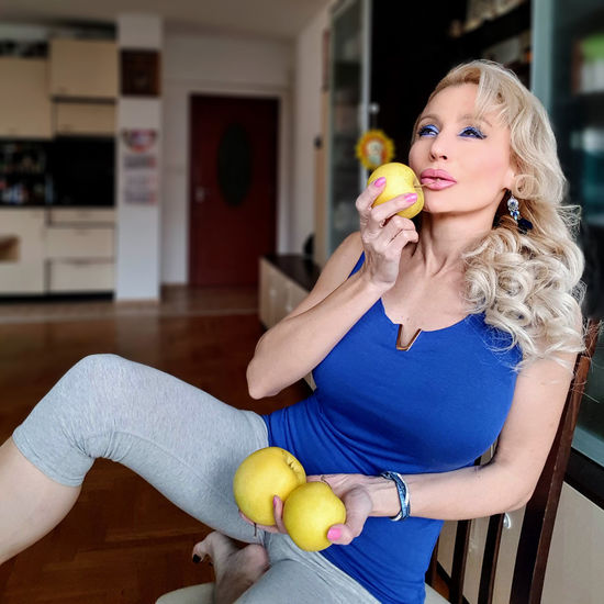 An apple a day keeps the doctor away Apple Apples Eating Holding Sitting Chair Tempting Temptaion Seducing Seductive Grace Graceful Elégance Blond Hair Young Women Beauty Fruit Holding Stuffed Toy Apple - Fruit Portrait Beautiful Woman Tennis Ball Holiday Moments A New Perspective On Life