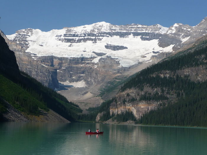 Jul 2009 Banff National Park  Lake Louise Lakeshore Trail Beauty In Nature Mountain Mountain Range Outdoors Red Canoe Scenics Snow Snowcapped Mountain Tranquil Scene Tranquility Travel Destinations Water Waterfront