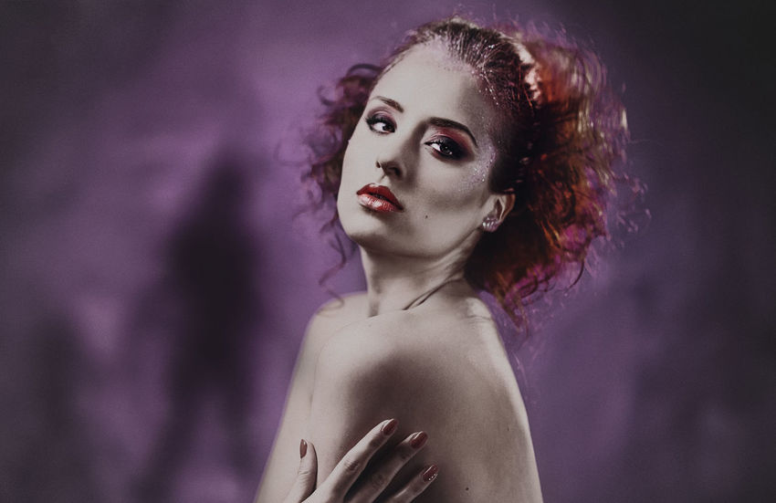 Portrait of beautiful young red-haired woman with a bright make-up. Studio shot Beautiful Woman Bright Colors Curly Hair Females Girl Glamour Horror Lips Make-up Makeup One Person People Pose Purple Background Redhead Sensual_woman Sexygirl Studio Shot Toplesswoman Violet Background Woman Young Adult Young Women