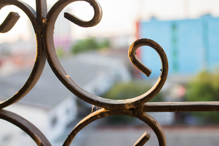 Barrier Boundary Circle Close-up Day Fence Focus On Foreground Geometric Shape Iron - Metal Metal Nature No People Outdoors Protection Railing Rusty Safety Security Shape Water Wrought Iron