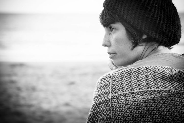 Close-up of woman sitting at beach
