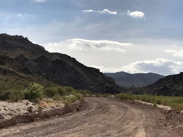 Mountain Landscape Sky Nature Beauty In Nature Road Tranquil Scene Tranquility Scenics Mountain Range Day No People Outdoors Winding Road Grass EyeEm Nature Lover Dirt Road Lake Mead National Recreation Area