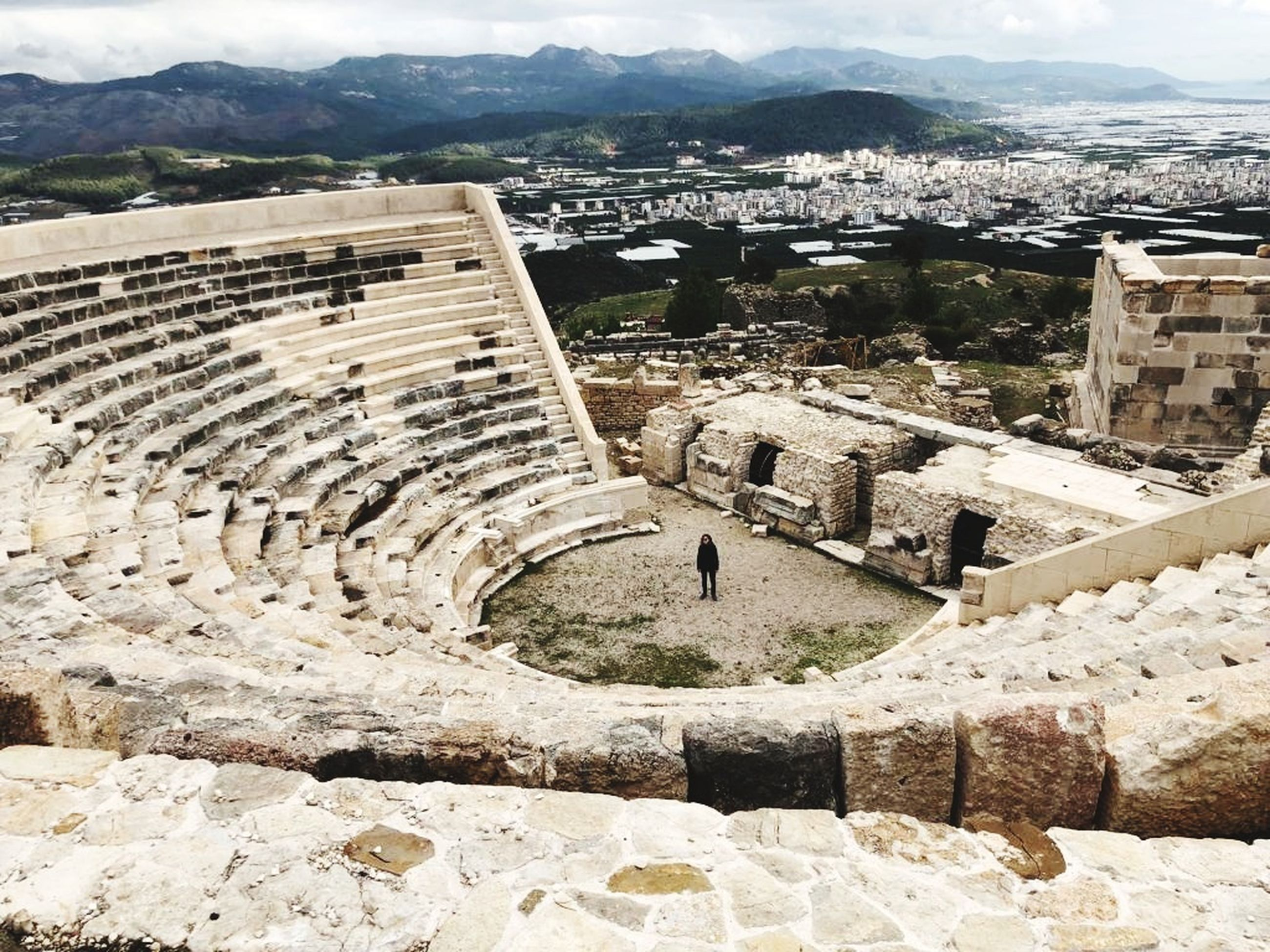 architecture, built structure, building exterior, history, the past, ancient, travel destinations, old ruin, day, high angle view, ancient civilization, building, mountain, tourism, nature, travel, old, amphitheater, no people, wall, outdoors, archaeology, ruined, cityscape, stone wall, ancient history