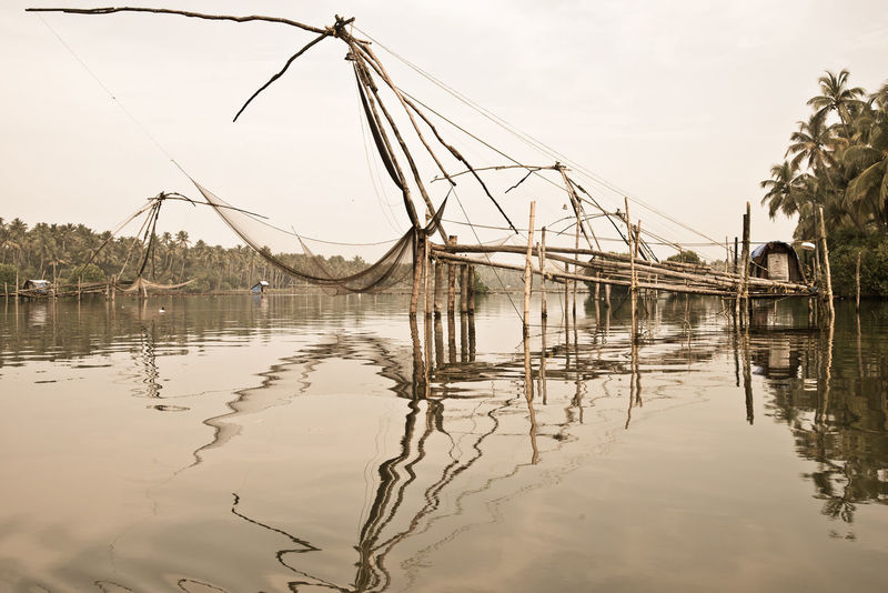 Kerala Backwaters Backwaters Of Kerala Beauty In Nature Chinese Fishing Nets India Jungle River No People Reflection Reflections Standing Water Tranquility Water