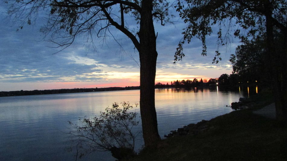 Late Evening Sky By The Lake Beautiful View Past The Trees Water Reflections Silence Lake Cadillac Pure Michigan