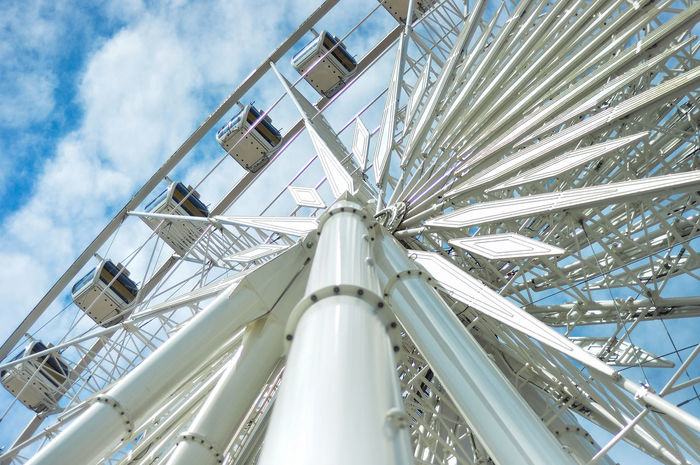 The core of the Ferris wheel on the bright sky background. Air-condition Built Structure Clouds And Sky Core Day Ferris Wheel High Industry Low Angle View No People Nut Outdoors Sky Steel Steel Structure  Technology Travel Tube Wheel White Color