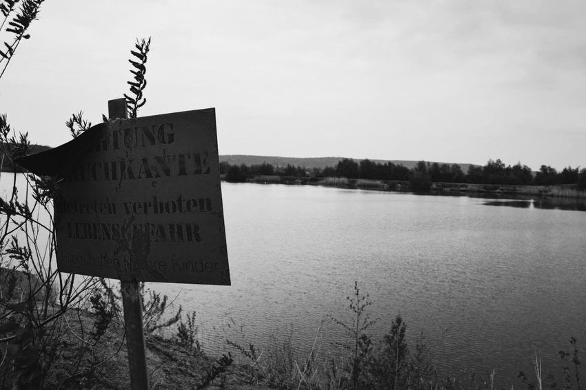 Western Script Communication Text Guidance Day Warning Sign Outdoors No People Warning Signboard Nature Sky Plant Road Sign Tree Close-up Art Is Everywhere Lake Summer Danger Dangerous Clear Sky Water Break The Mold The Great Outdoors - 2017 EyeEm Awards