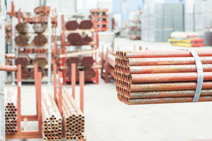 Stack of steel pipes for scaffolding in warehouse Construction Equipment Focus On Foreground Industrial Industry Large Group Of Objects Pipe Scaffolding Stack Tubes