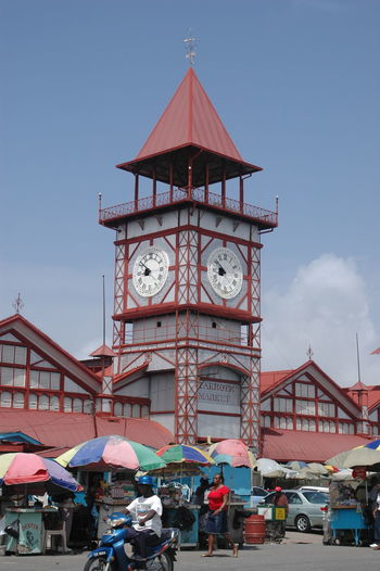 Architecture Building Exterior Built Structure Clock Large Group Of People Lifestyles Outdoors Real People Stabroekmarket
