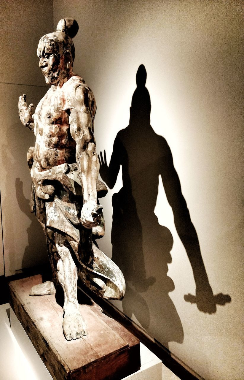 human representation, representation, art and craft, sculpture, statue, male likeness, creativity, indoors, no people, museum, craft, wall - building feature, history, the past, architecture, shadow, figurine, still life