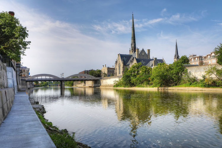 Sunny morning by the Grand River in Cambridge Church Quiet Reflection Architecture Bridge - Man Made Structure Building Exterior Built Structure City Cloud - Sky Day History Landscape Nature No People Outdoors Peaceful River Serene Sky Travel Destinations Tree Village Water Waterfront