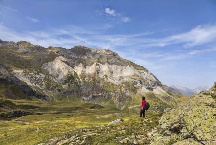 Female hiker admiring the beautirul landscape inside the glacial Cirque de Troumouse in Pyrenees,France. Glacial Circus Landscape_Collection Pyrenees National Park Adventure Backpack Backpacker Beauty In Nature Cirque De Troumouse Exploration Healthy Lifestyle Hiker Hiking Landscape Landscape_photography Leisure Activity Lifestyles Mountain Mountain Range Nature One Person Real People Rock - Object Scenics Vacations