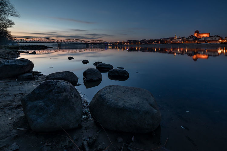 Water Rock Solid Sky Rock - Object Reflection No People Nature Tranquility Architecture Scenics - Nature Built Structure Dusk Tranquil Scene Illuminated Beauty In Nature Sea Building Exterior Sunset Outdoors Toruń Torun, Poland Wisła River Vistula Polska