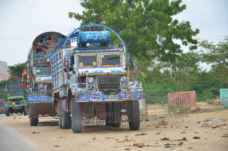 Water tankers going to the famine stricken Tharparkar desert - Pakistan. No Water Pakistan THARPARKAR Clear Sky Famine Motor Vehicle No Water - No Wave Outdoors Road Sindh Transportation Water Western Script