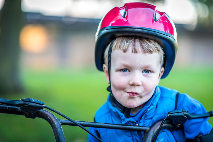 Portrait Of Smiling Boy With Bicycle