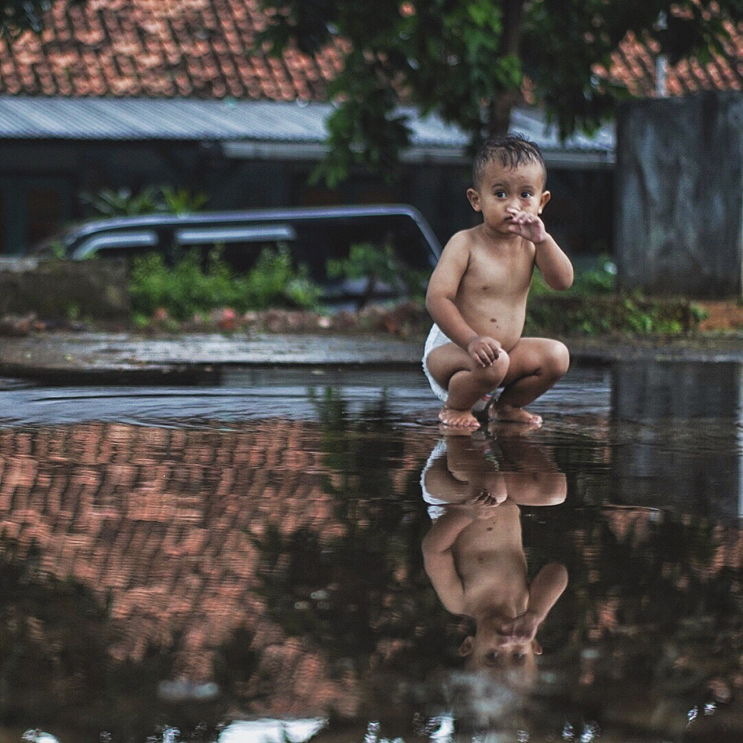 child, sitting, males, childhood, full length, outdoors, summer, one person, portrait, day, shirtless, people, nature, water
