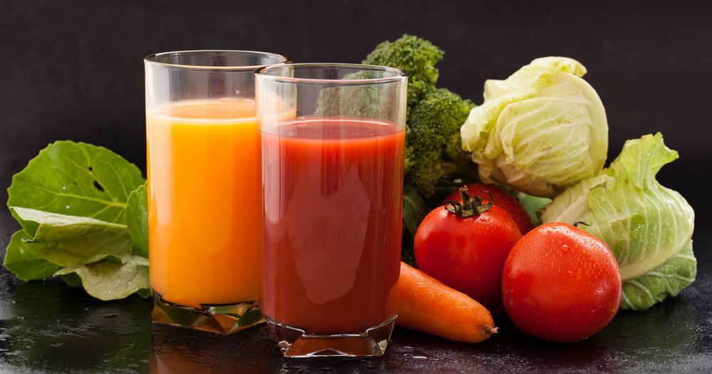 Close-up of juice and drink on table