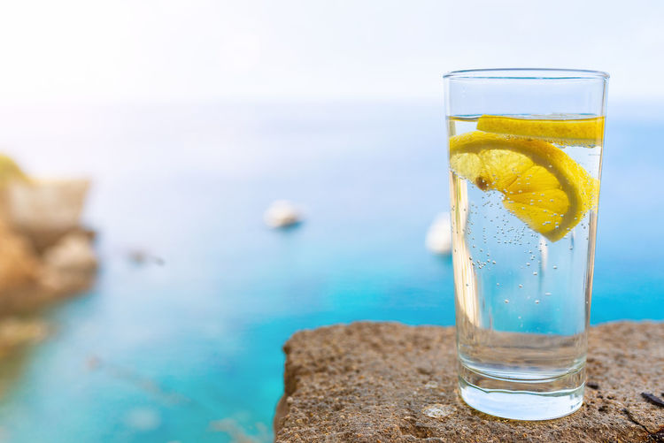 Beverage Lemonade Sunlight Close-up Day Drink Drinking Glass Focus On Foreground Food And Drink Freshness Glass Lemon Lemon Slice Nature No People Refreshment Sea Summer Transparent Water