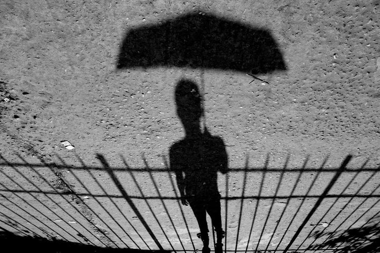 Focus On Shadow One Person Outdoors People Shadow Umbrella Urban Life The City Light