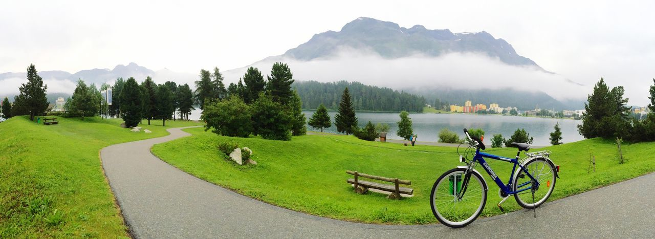 Cycling CyclingUnites Cycle Mountain Beauty In Nature Nature Misty Mist Misty Morning Tree Tranquility Green Color Tranquil Scene Scenics Transportation Grass Sky Mountain Range Mode Of Transport No People Outdoors Stationary Water Day Lieblingsteil