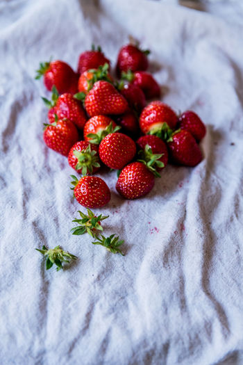 High angle view of strawberries on table
