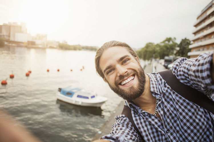 Portrait of smiling young man in boat
