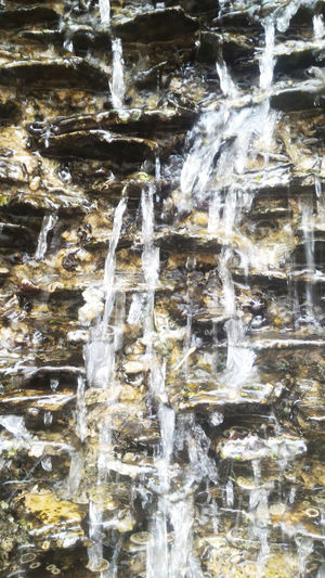 Water falls on the stacked rock. Nature Rock Stone Stone Layers Water Waterfall On The Rock Watertal