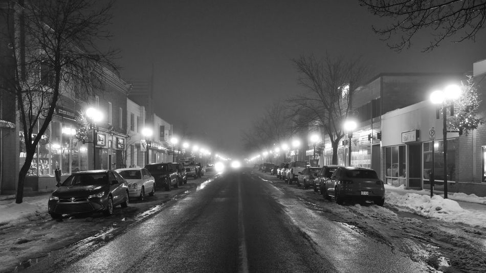 Street at night with cars and lights Illuminated Street Light Street Car Night Transportation Road Lighting Equipment Snow outdoors Lowkey  Blackandwhite Black And White Outdoor Outside