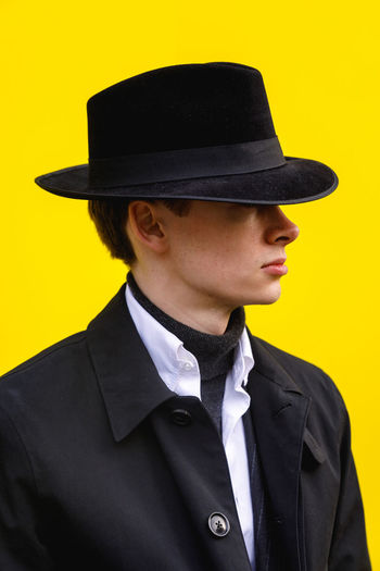 London Fashion Week Mens 2019 Redefining Menswear Clothing One Person Yellow Hat Portrait Front View Young Adult Young Men Headshot Real People Men Lifestyles Suit Formalwear Well-dressed Yellow Background Contemplation Uniform Menswear Fashion Fashion Photography Mensfashion London Portrait Photography