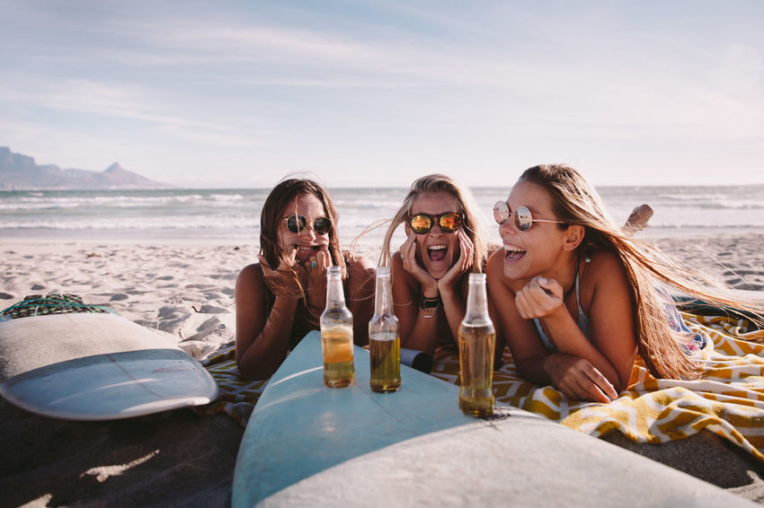 Leisure Activity Water Friendship Beach Sky Land Drink Sea Togetherness Young Adult Real People Vacations Lifestyles Holiday Trip Refreshment Young Women Nature Food And Drink Fashion Drinking