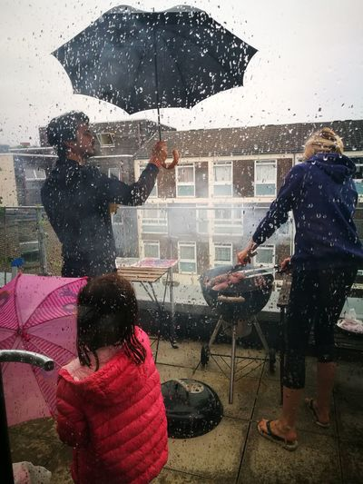 a very british barbeque, city life, rain Barbeque Time Barbeque BBQ Rooftop Summer Showers City Life London lifestyle Water Window Washer Friendship Drop Men Rainfall Umbrella Rain Looking Through Window Shower The Great Outdoors - 2018 EyeEm Awards