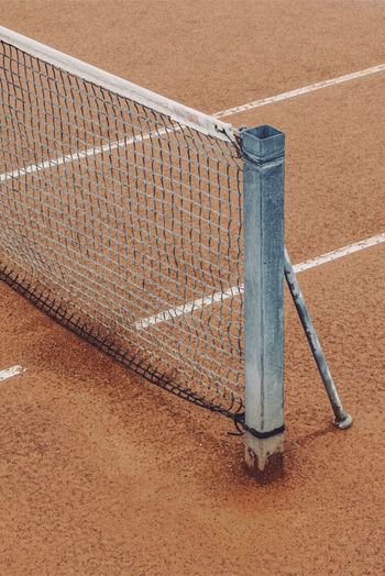 High angle view of sports net on sand